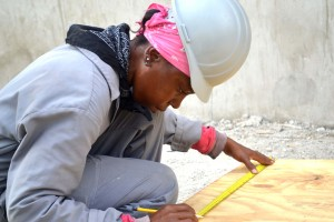 Female participant takes measurement for building    construction - CSJP...