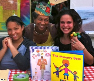Jamaican Pamela Groves (center) with two writers and their books at her Baby Wordplay's Little Theater in Philadelphia, Pennsylvania.