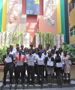 The students pose for their photograph in JAMPRO's lobby.