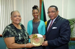 Jamaica Business Development Company (JBDC) CEO, Valerie Veira (left), Winner of the JBDC Entrepreneur of the Year award and Managing Director of Bartley's All in Wood, Lacey-Ann Bartley (centre) and Industry, Investment and Commerce Minister, the Hon. G. Anthony Hylton (right) are all smiles as Bartley is presented with the JBDC Entrepreneur of the Year Gold Plate in July 2014. Lacey-Ann is a Branson Centre Entrepreneur. (Photo: JIS)