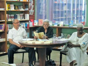 Pamela Mordecai reads, with Earl McKenzie and Jean Small on either side.