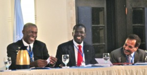 (l-r)  Minister Claude Hogan, Government of Montserrat; and Dr. Arun Kashyap, Resident Coordinator, United Nations Development Programme and Resident Representative in Jamaica, sharing a joke at the Opening Session on February 23 at the Jamaica Pegasus Hotel.
