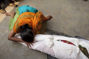 Victim of corruption: A woman grieves over the body of a factory worker killed in the building collapse at Rana Plaza, Bangladesh. (Photo: K M Asad).