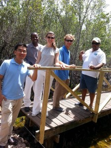 Brandon Hay (far right) gives visitors from the U.S. Embassy a wetlands tour in the Portland Bight Protected Area. (Photo: Caribbean Coastal Area Management Foundation/Facebook)