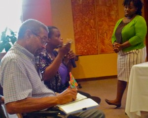"Associate Editor at the Jamaica Observer Kimone Thompson (right) conducts a ""vox pop"" with the citizens. (My photo)"