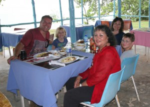 Diana McIntyre-Pike (in red) with a visiting family at a seafood restaurant in Westmoreland. (Photo: Countrystyle Community Tourism Network/Facebook)