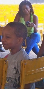 This little boy loved the storytelling session. In the background is children's author Kellie Magnus.