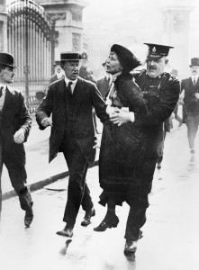 Mrs. Emmeline Pankhurst, leader of the women's suffragette movement, is arrested outside Buckingham Palace while trying to present a petition to King George V in May, 1914.