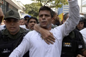 Jailed Venezuelan opposition leader Leopoldo López, shown above being escorted by National Guardsmen in 2014, has ended a one-month hunger strike, after the government on Monday set a date for the next parliamentary elections. (Photo: Juan Barreto/AFP/Getty Images)