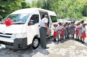 The students line up to get on their brand new bus, which the school won in a Toyota competition last year.