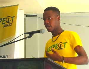 "I did not mention the touching comments by Respect Jamaica Ambassador Raheem Lawrence. ""Men need space to express themselves,"" he urged, ""In an atmosphere where we can discuss our problems."" When he was growing up, other youth threw stones at him and called him names, because he was ""different."" (My photo)"