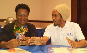 Latoya West-Blackwood and a former colleague in UWI's Marcus Garvey Movement Allan Bernard get together at the NIA training session in September. (My photo)