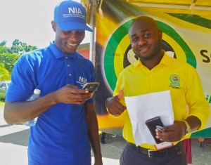 National Integrity Action's Richard Pasley (left) and Parish Manager at the Social Development Commission Alric James at the Health and Information Fair. The NIA and SDC were co-sponsors of the Fair. (My photo)