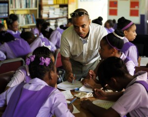 Dr. Leo Douglas interacting with Jamaican high school students.