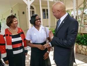Phase Three Production Chairman Dr. Marcia Forbes (left) and Makeda Bawn (center) talk to Governor General Sir Patrick Allen at King's House in September, 2014. (My photo)