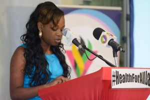 """Nineteen year-old Andreen Williams, a client of Eve for Life, which supports young mothers living with HIV, gave a welcome at the """"Health for All"""" forum. (Photo: JYAN/Facebook)"""