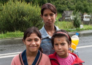 "Three Roma girls in Romania. The Roma (often called ""gypsies"") constitute one of the largest minorities in Romania. They have suffered from persecution, prejudice and discrimination in Britain and elsewhere in Europe for centuries. Credit: dinosmichail / Shutterstock.com"