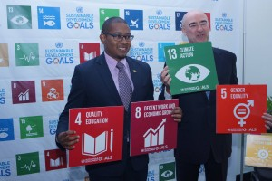 Junior Minister in the Ministry of Education, Youth and Information Floyd Green (left) with UNDP Resident Representative Bruno Poezat at the Social Good Summit. (Photo: UNDP)
