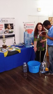 "Getting a ""hands on"" demonstration of the Pump N Spray from Jovan Evans at the Social Good Summit."