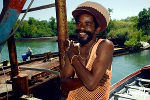 In Jamaica, merino has nothing to do with wool. Here is reggae singer Cocoa Tea wearing one - it's a nice mesh tank top. It is particularly abhorrent in offices - even in bars and entertainment places in some cases.