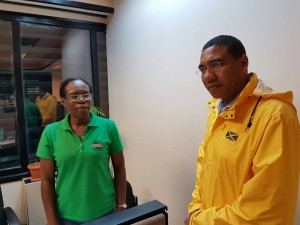 Prime Minister Andrew Holness, in his waterproof gear, at the ODPEM office while Hurricane Matthew was hanging around. (Photo: Office of the Prime Minister)
