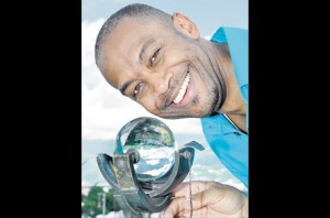 Head of the Meteorological Service of Jamaica Evan Thompson, with a sunshine recorder. (Photo: Naphtali Junior/Jamaica Observer)