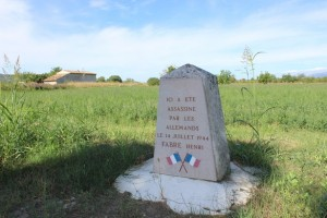"""Here Henri Fabre was killed by the Germans, July 14, 1944."" The rural spot where a member of the French Resistance was caught and executed by the Germans during World War II. (Photo: atlasobscura.com)"