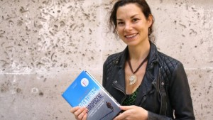 Gaia Vince with her award-winning book on the Anthropocene. (Photo: BBC)