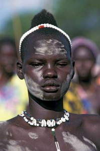 A Dinka woman in South Sudan. (Photo: Marc Nanzer—Impact Photos/Heritage-Images)
