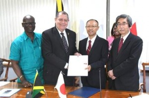 Where is ODPEM in this photo? Finance Minister Audley Shaw (second left) shakes hands with Kenji Tobita, resident representative of the Japan International Cooperation Agency, after signing the grant agreement at the finance ministry in Kingston last week. Sharing in the occasion are Minister of Local Goverment and Community Development Desmond McKenzie (left) and Japan Ambassdor to Jamaica Masanori Nakano. (Photo: Bryan Cummings/Jamaica Observer)