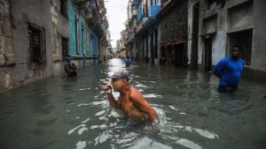 We have seen so many images like this... wading through water. Cubans wade through a flooded street in Havana on Sunday. (Yamil Lage / AFP/Getty Images)