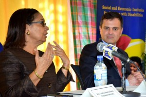 Minister of Labour and Social Security, Hon. Shahine Robinson (left), addresses the media after a tour of the Early Stimulation Programme (ESP) multipurpose facility on Hanover Street, on Thursday (June 8). At right is Vice-President of Countries at the Inter-American Development Bank (IDB), Alexandre Meira da Rosa. (Photo: JIS)