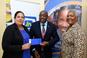 JN Foundation's Saffrey Brown (left) makes a donation to United Way of Jamaica. At right is CVSS CEO Winsome Wilkins. (Photo: United Way of Jamaica website)