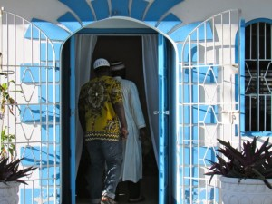 Members of the Muslim community enter the headquarters of Jamaica's Baha'i community for World Religion Day. (My photo)