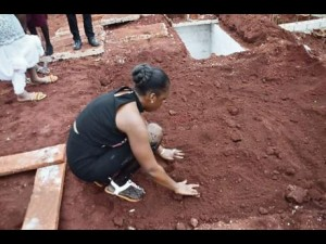 The sister of murder victim Romaine Whyte, 30, whose funeral was marred by a shooting last year, mourns his passing. Another young man is dead. (Photo: Jamaica Star)
