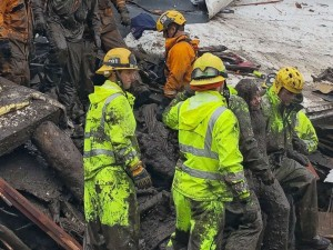 irefighters rescue a 14-year-old girl trapped inside a destroyed home during heavy rains in Montecito, Calif., Jan. 9, 2018. Heavy rains overnight combined with large areas burned by the Thomas Fire combined for flash flooding and mudslide risk. Mike Eliason/Santa Barbara County Fire via EPA