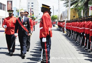 Governor General Sir Patrick Allen inspects the Guard of Honour outside Gordon House prior to the official Opening of Parliament. (Photo: Kings House)