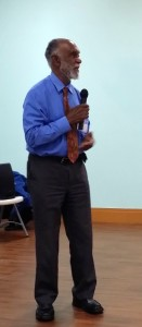 Dr. Owen James speaks warmly to the audience. (My photo)