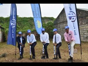 Tourism Minister Edmund Bartlett (centre) and Minister without Portfolio in the Ministry of Economic Growth and Job Creation, Dr Horace Chang (second right) break ground for the development of Hampden Wharf, located along the historic Falmouth Pier, on March 16, 2018. Joining the Ministers are (from left) Mayor of Falmouth, Councillor Colin Gager; Port Authority of Jamaica President, Professor Gordon Shirley; and Member of Parliament for North Trelawny, Victor Wright. J$500 million. (Photo: JIS)