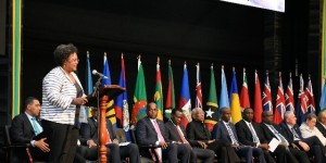 A woman talks to the men at CARICOM's 39th Heads of Government meeting. (Photo: CARICOM)
