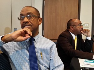 Director of the Meteorological Service of Jamaica Evan Thompson (foreground) answers a question, while Director General of ODPEM Major Clive Davis seems deep in thought. (My photo)