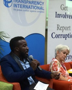 Commonwealth Youth Peace Ambassador Neville Charlton (left) speaks while Dr. Elizabeth Ward, Violence Prevention Alliances listens at the Youth Forum. (My photo)