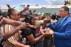 PHOTO: RUDRANATH FRASER Prime Minister, the Most Hon Andrew Holness (right), greets residents of St. Thomas during the groundbreaking ceremony for the construction of the new Morant Bay Urban Centre in Springfield in the parish on Wednesday (June 26).
