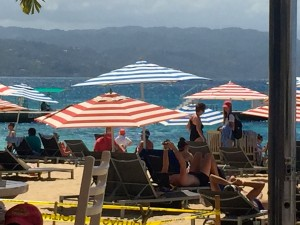 The allure of the beach - but not to swim: Doctor's Cave, Montego Bay on a busy day. (My photo)
