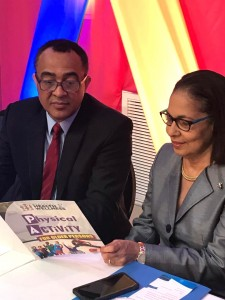 """Ministers Tufton and Robinson peruse the booklet """"Physical Activity for Older Persons."""" (My photo)"""