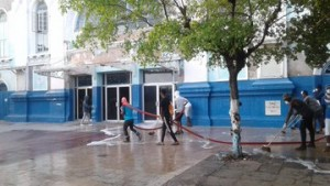 Employees of the Kingston St. Andrew Municipal Corporation (KSAMC) cleaning in front of the Ward Theatre downtown. (Photo: Mayor Williams/Twitter)