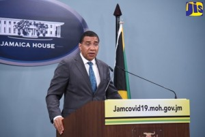 Prime Minister Andrew Holness speaks at a press briefing, streamed live on several platforms,  on April 8 at Jamaica House. (Photo: Adrian Walter/JIS)