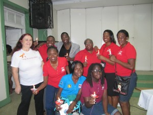 A group photograph from a few years ago on World AIDS Day, with Joy Crawford (centre, in red).
