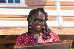 An inspiring Caribbean woman: Orisha Joseph, Sustainable Grenadines Executive Director, welcomes everyone to the Ashton Lagoon Restoration Project Unveiling event on May 31st, 2019. The project took literally decades to come to fruition. Hence, the broad smile! (Photo by Sustainable Grenadines, Inc.)